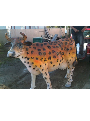 Custom painted life size cow statue