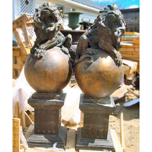 Pair of Bronze Lions on Bronze Ball with Marble Pedestals