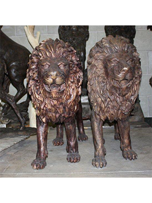Pair of Bronze Walking Lions